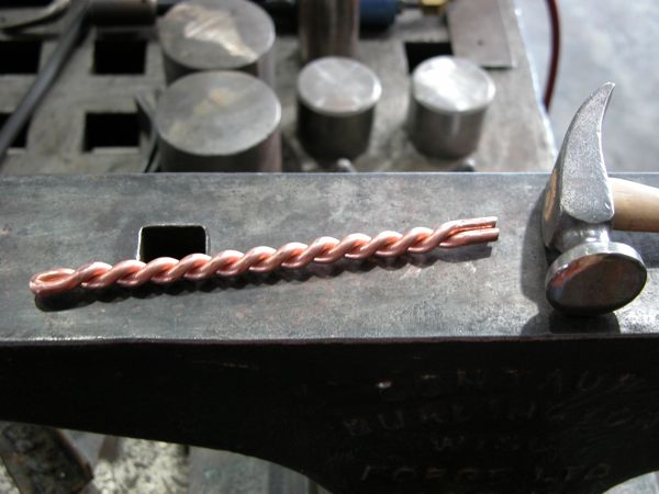 In The Middle Of Wire Fold It Half With Notch Inside And Using A Polished Wide Faced Hammer Such As Jeweler S